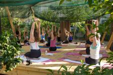The outdoors yoga shala in use